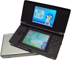 Nintendo DS Lite in Silver and Black running Super Mario Brothers