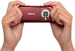 Nokia N73 mobile phone - hand held showing camera